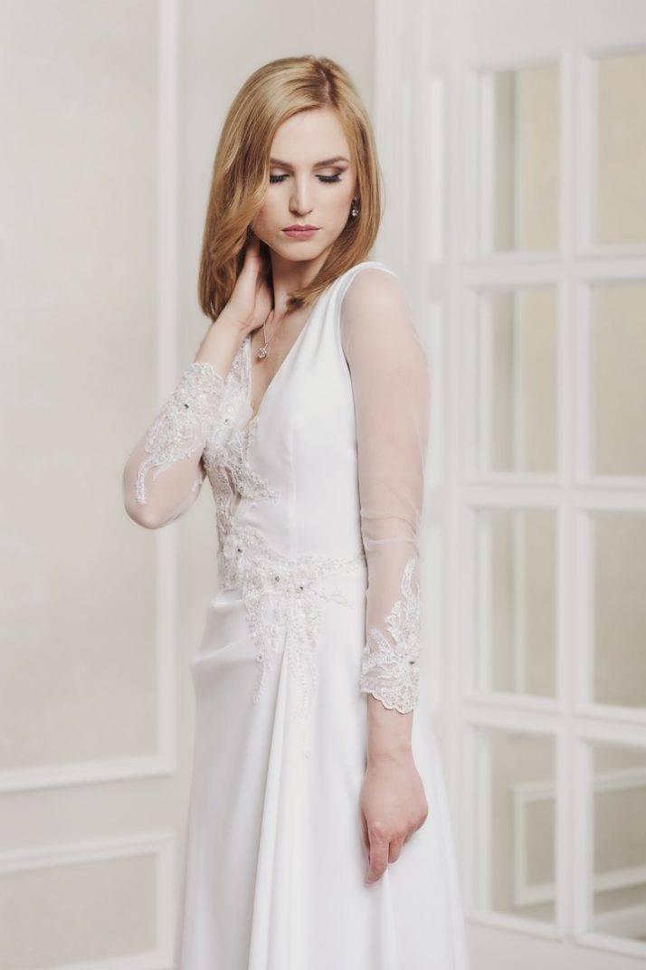 suknia ślubna zrękawem zesrebrem